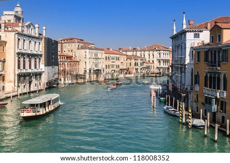 The Grand Canal in Venice in spring with boats running on the canal