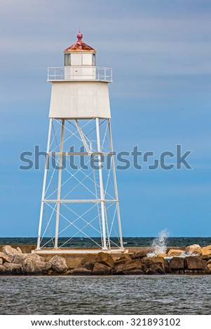 The Grand Marais Rear Range Light shines it beacon to aid vessels entering the harbor of the small town on Upper Peninsula Michigan's Lake Superior coast. - stock photo
