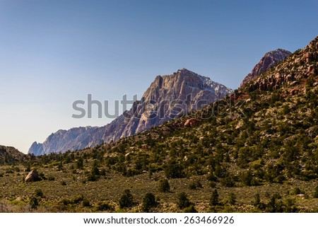 The grand vista at Red Rock Canyon Conservation Area near Las Vegas, Nevada in the middle of the day. The mountains are amazing there.  - stock photo