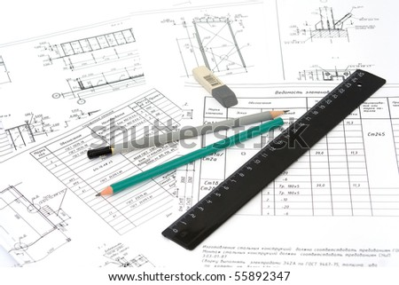 The graphitic pencil lies on drawings - stock photo