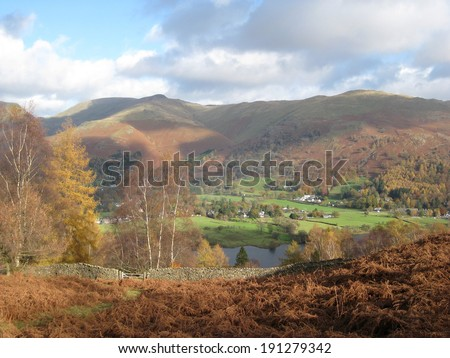 The Grasmere Valley in the Lake District National Park in Cumbria, northern England with the Rydal Fells in the Distance. - stock photo