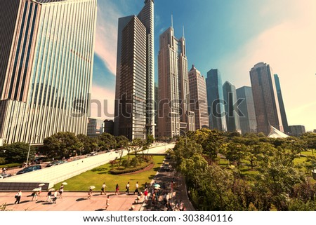 The grass and the city in shanghai,china - stock photo