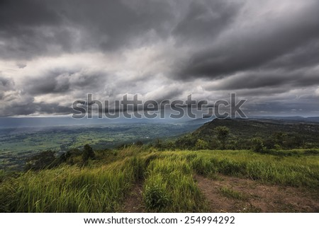 The grass on the hill in the rainy season - stock photo