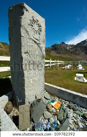 The Grave of Sir Ernest Shackleton, Antarctic explorer who died in Grytviken on the 5th January 1922. He is buried in the old whaler's cemetery overlooking the bay. - stock photo