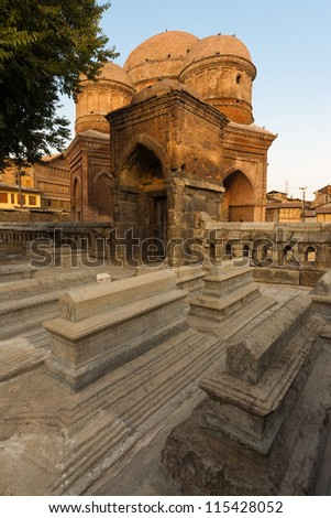 The graves at the rear of Budshah Tomb, a tourist attraction in Srinagar, Kashmir, India - stock photo