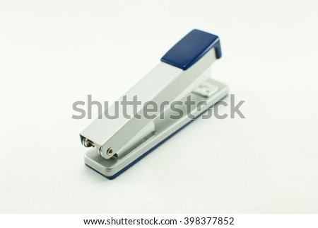 The gray-blue stapler on the white background. Isolated