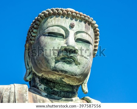 The Great Buddha statue of Kamakura (Daibutsu) in the Kotoku-in Temple, Japan, under clear blue sky.