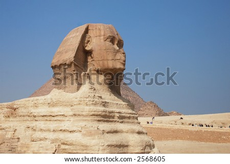 The great egyptian Sphinx of Giza with ancient pyramids on the background