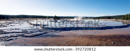 The Great Fountain Geyser is a fountain-type geyser located in the Firehole Lake area of Lower Geyser Basin of Yellowstone National Park, Wyoming, US - stock photo