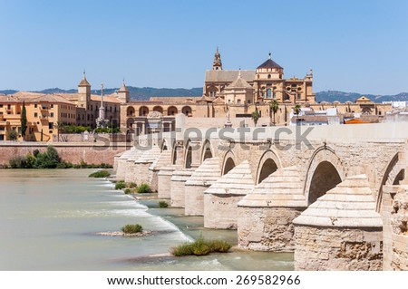 The Great Mosque and Roman Bridge in Cordoba in Spain - stock photo
