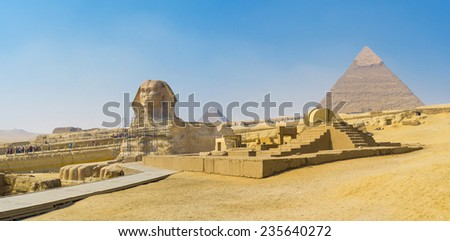 The Great Sphinx is a colossal limestone statue located next to the Pyramids of Giza in Egypt. - stock photo