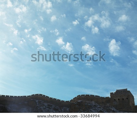 The Great Wall and blue sky decorated with cloud. - stock photo