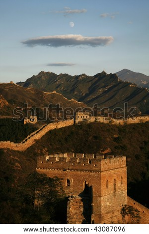 The Great Wall at daybreak. with cloud and moon over head. - stock photo