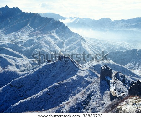 The Great Wall in winter covered with frost. - stock photo