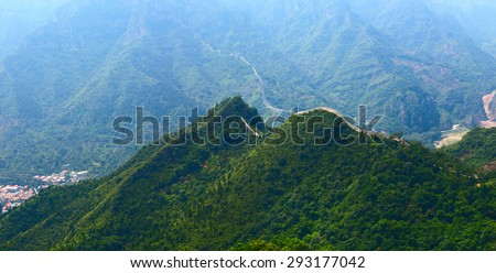 The Great Wall of China (Yellow Cliff). The main Great Wall line stretches from Shanhaiguan in the east, to Lop Lake in the west, along an arc that delineates the southern edge of Inner Mongolia - stock photo