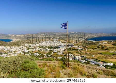 The Greek flag in a picturesque place - Plaka village, views of the coast, Milos island, Cyclades, Greece. - stock photo