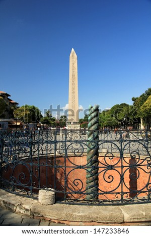 The greek Serpent Column (front) and the egyptian Obelisk of Theodosius are the famous monuments of antiquity. istanbul Sultanahmet, Turkey - stock photo