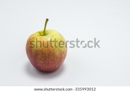 The green apple on the white background