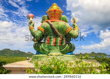The Green Ganesha sitting outside overlooking the Gulf of Thailand as a background, Chumphon, Thailand. - stock photo