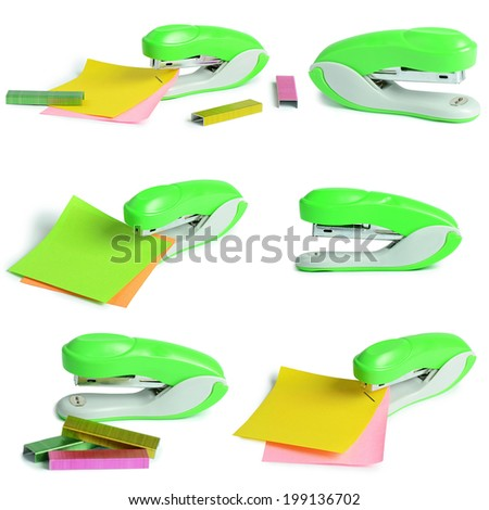 The green stapler isolated on white background - stock photo