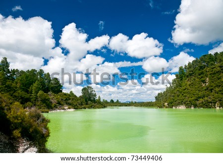 The green water of Lake Ngakoro at Wai-O-Tapu geothermal area in New Zealand - stock photo