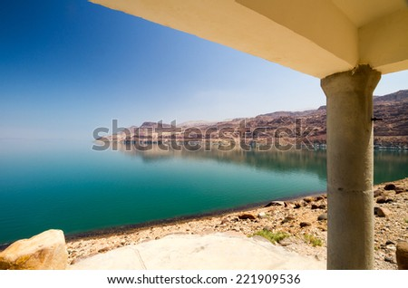 The green waters of the land-locked Dead Sea in Jordan from a cottage by the entrance to Wadi Mujib, on the Jordan side. - stock photo
