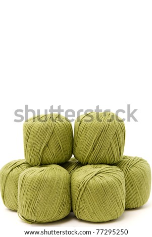 the green yarn skeins isolated on white - stock photo
