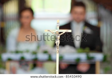 The groom and bride at the wedding ceremony in church - soft focus - stock photo