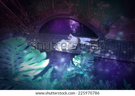 The groom and the bride in a tropical garden, Thailand - stock photo