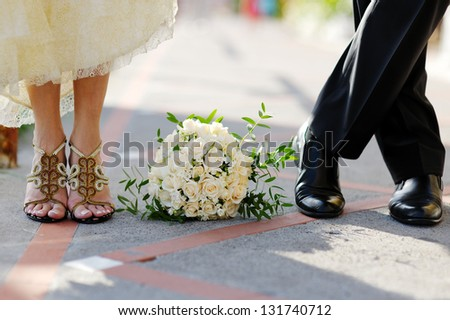 The groom and the bride with a wedding bouquet
