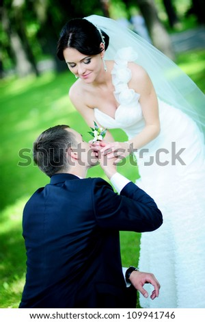 the groom makes an offer. beautiful wedding couple - stock photo