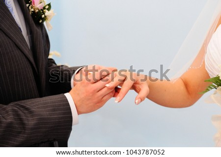 Groom Puts On Wedding Engagement Ring Stock Photo 1043787052