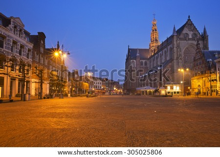 The Grote Markt square and the St. Bavo Church in Haarlem at night.