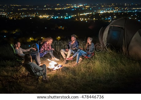 The group of people rest on the nature and make a barbecue. Wide angle