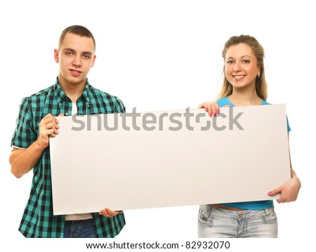 The group of young people holds the empty board for the text