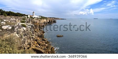 The Guia Lighthouse on the rugged ocean coast of Cascais, Portugal - stock photo
