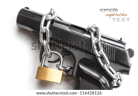 the gun coiled chain closed by a padlock - stock photo
