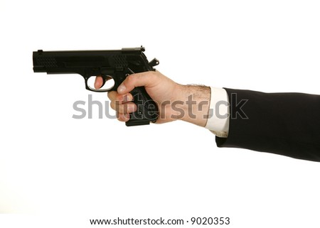 the gun in hand. ISolated - stock photo