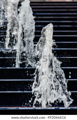 The gush of water of a fountain