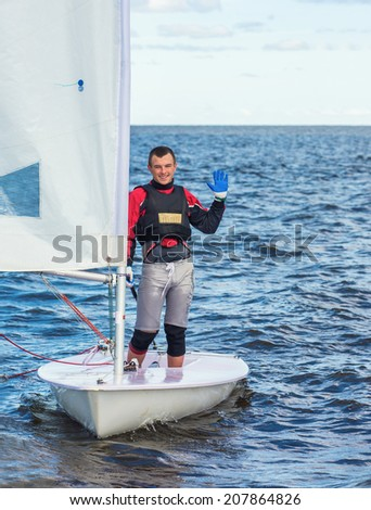 The guy costs on a sports yacht - stock photo