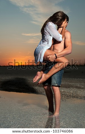 the guy holding the girlfriend on his back - stock photo