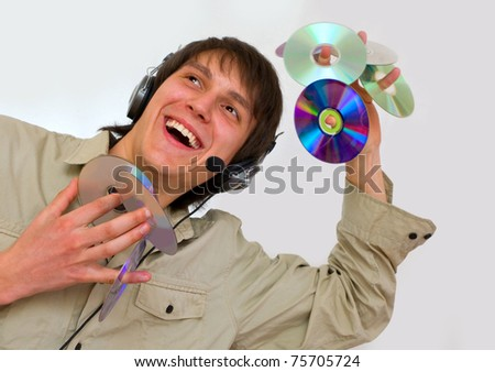 the guy listening to rhythmic music in the headphones