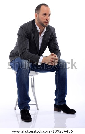 the guy sitting on a chair - stock photo
