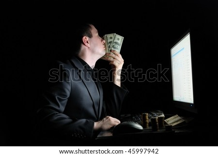 The guy smells money at the monitor - stock photo