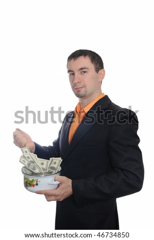 The guy stirs money a ladle in a pan. Isolation on  white - stock photo