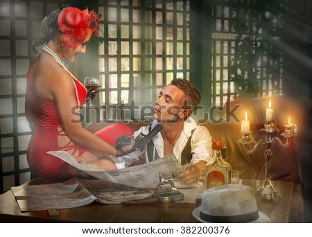 the guy with the girl in the cafe at the table - stock photo