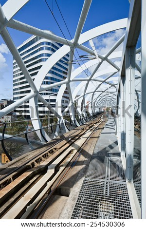 THE HAGUE-AUGUST 23, 2014. Cylindrically shaped frame around elevated subway track in the city center. Hague residents have given the remarkable white structure the nickname fishnet stockings.