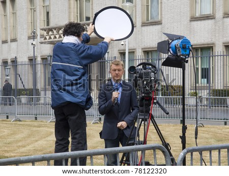 THE HAGUE, HOLLAND - MAY 27: Reporter of German television WDR 1at the trial for war crimes of Serbian ex-general Mladic at the Yugoslavia Tribunal in The Hague, Holland on May 27, 2011 - stock photo