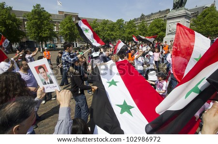 THE HAGUE, HOLLAND - MAY 19: Syrians demonstrate for Syria and Assad in the center of The Hague, Holland on May 19, 2012 - stock photo