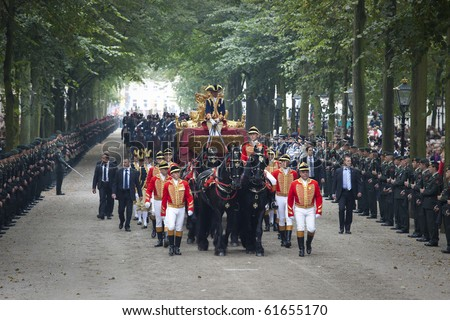 THE HAGUE, HOLLAND - SEPT 21: The golden coach with Queen Beatrix and royal Princess Maxima on Prinsjesdag (opening of parliamentary year by Queen) on September 21, 2010 in The Hague, Holland.